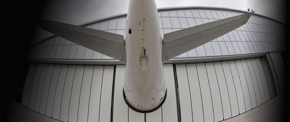 Hangar doors & Industrial and insulated sliding folding doors | hangar door supply ...